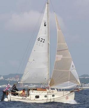 Summer 2006. The Tsurutas enjoy their first sailing aboard their new Flicka in Okinawa, Japan. (Her sail # reflects one of her previous owner's birthday.)
